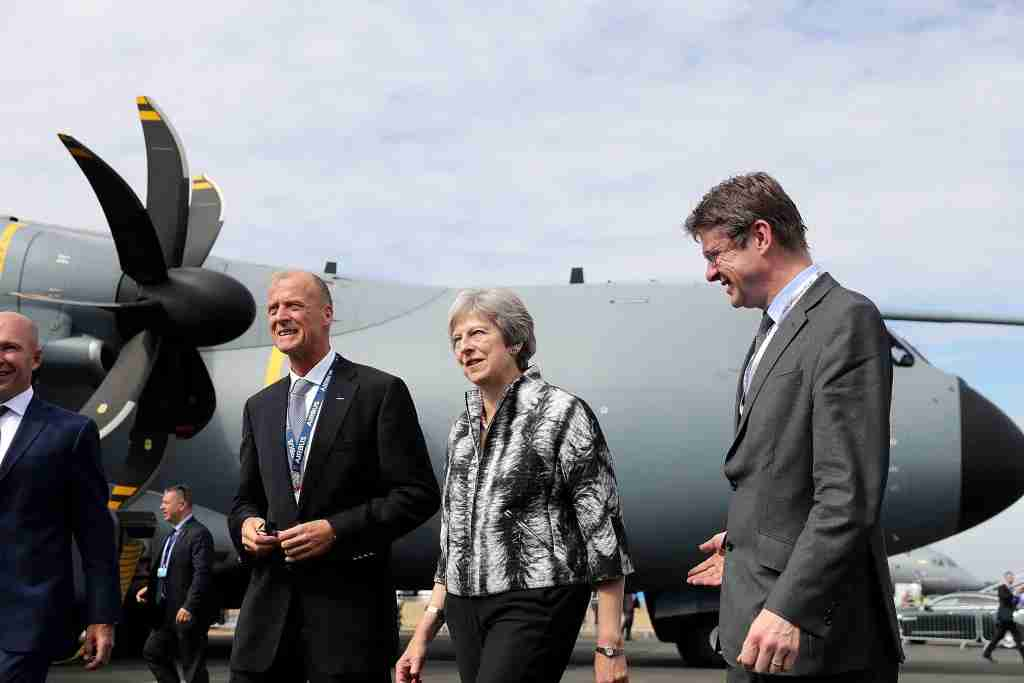 FARNBOROUGH, ENGLAND - JULY 16: British Prime Minister Theresa May talks with Airbus CEO Tom Enders (L) as she opens the Farnborough Airshow on July 16, 2018 in Farnborough, England. Theresa May opened the Farnborough Airshow today with a speech pledging £300 million for a variety of research projects for the aerospace industry. Recently Bristol-based firm Airbus said it may have to move premises out of the UK after Brexit. (Photo by Matt Cardy - WPA Pool/Getty Images)