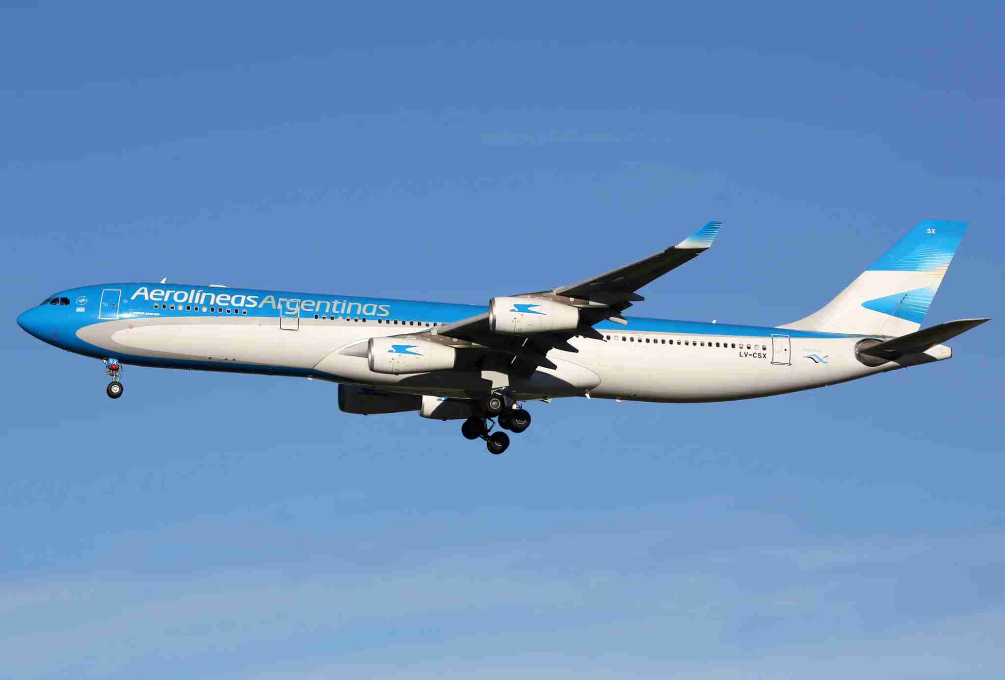 Madrid, Spain - March 5, 2015: An Aerolineas Argentinas Airbus A340 with the registration LV-CSX landing at Madrid Airport (MAD). Aerolineas Argentinas is the Argentinian flag carrier airline with its headquarters in Buenos Aires.