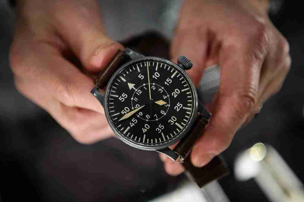 LONDON, ENGLAND - JANUARY 05: A man holds a Wempe aviator watch from 1943 (£5200) at the Mayfair Antiques and Fine Art Fair on January 5, 2017 in London, England. Running from January 5 to Sunday 8, the fair sees over forty exhibitors with pieces ranging from 1300BC to the present day available for sale. (Photo by Leon Neal/Getty Images)