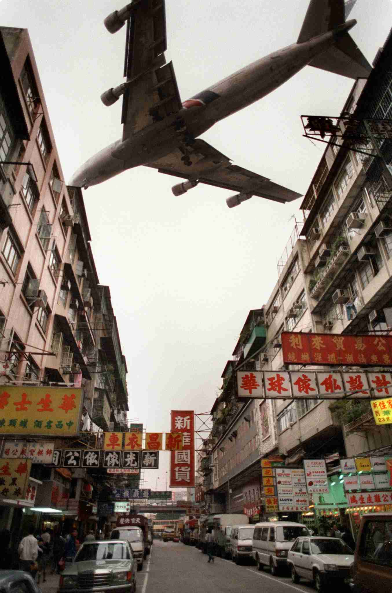 A jetliner screeches past the ageing and tatty apartment blocks of Kowloon city where aircraft landing and taking off Kai Tak international airport seem to just shave past a forest of TV antennas and batteries of roof-mounted airport lights. People of Hong Kong fear that Hong Kong