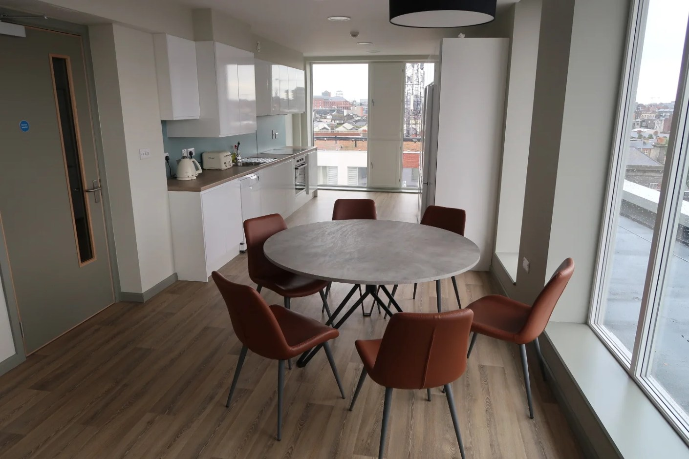 The shared kitchen and dining area in our student housing apartment.