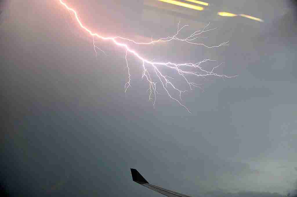 Lightning is seen through the window of the Malaysian Airlines plane over the Kuala Lumpur city on November 29, 2010.  Lightning is generally produced by thunderstorms, and occures through the discharge of charged electrons in the atmosphere.     AFP PHOTO / Saeed Khan (Photo credit should read SAEED KHAN/AFP/Getty Images)