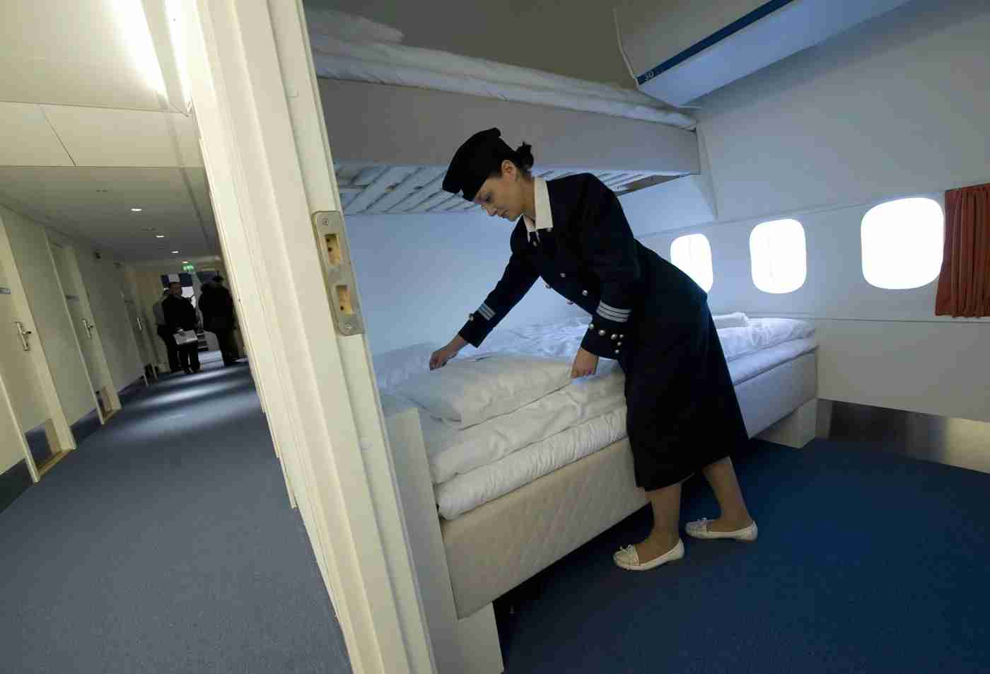 Local Manager Gisela Olsson makes a bed in one of the standard rooms of the Jumbo Hostel, reportedly the worlds first hostel in an airplane, at Arlanda airport in Stockholm on January 14, 2009. There are 74 beds in the retired Boeing 747-200 divided into dormitories and rooms with three beds, double beds, and a wedding suite in the cockpit. AFP Photo / Fredrik Sandberg / SCANPIX ** SWEDEN OUT ** (Photo credit should read FREDRIK SANDBERG/AFP/Getty Images)