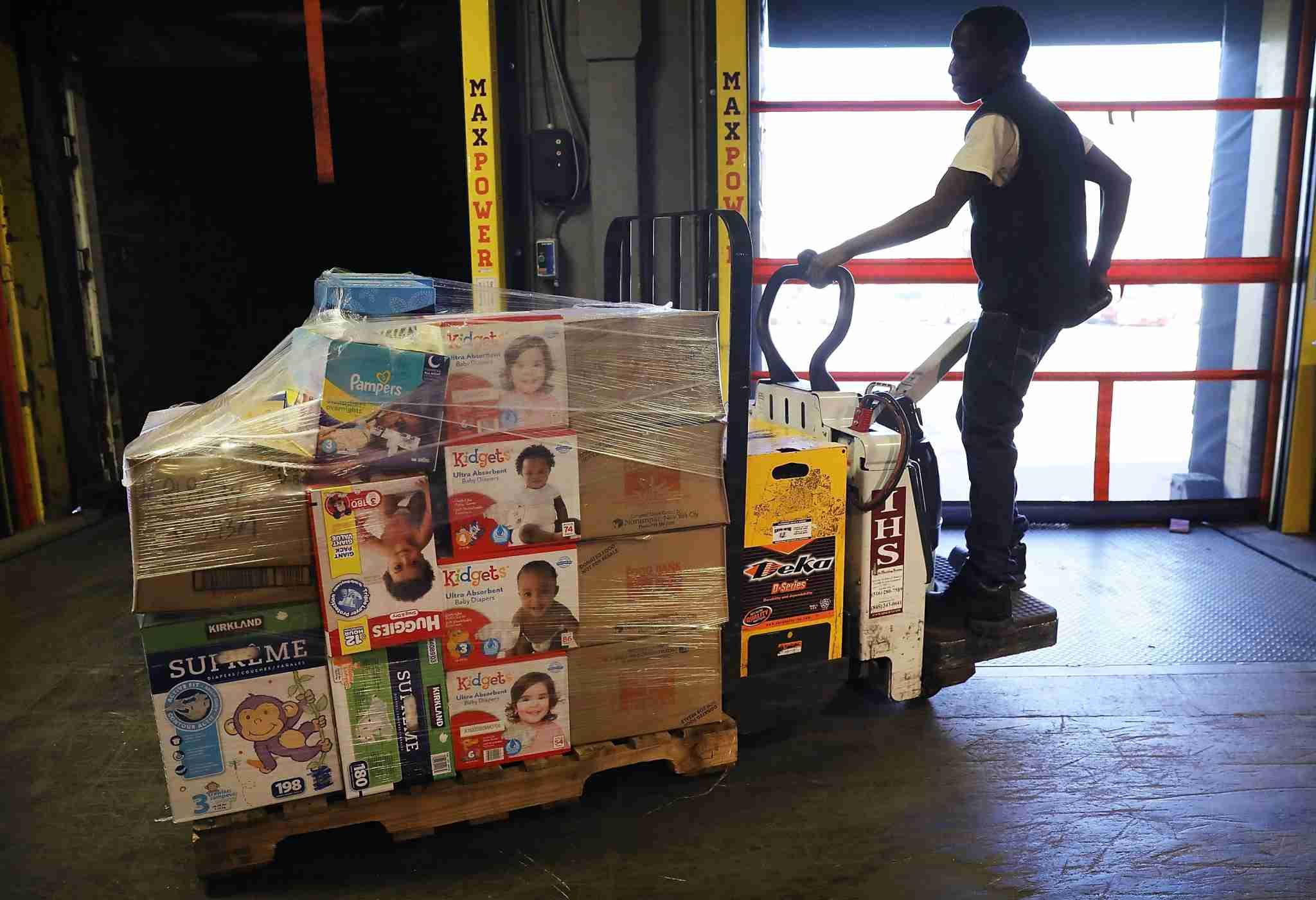 NEW YORK, NY - SEPTEMBER 29: A worker for the Food Bank For New York City moves a pallet of food headed to needy Americans in hurricane ravaged Puerto Rico on September 29, 2017 in New York City. Two trucks filled with bottled water, diapers, personal care items and food left the food bank