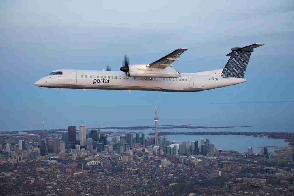 A Porter Airlines Q400 Turboprop; Toronto skyline in view. (Image via Porter Airlines)