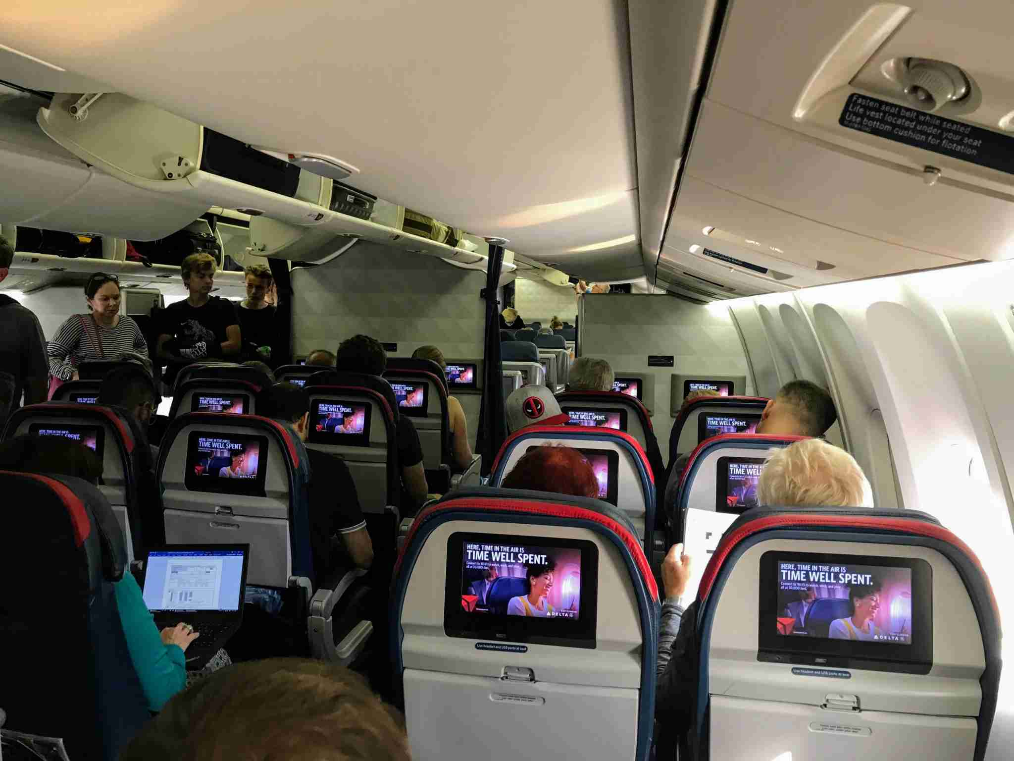 Passengers get seated in Delta Comfort+ onboard a Boeing 767-400