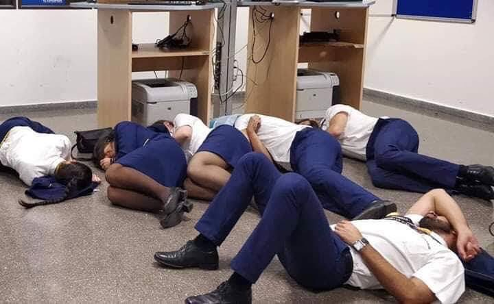 The staged photo showing the stranded Ryanair crew laying on the floor at Malga Airport in Spain (Image Courtesy of Jim Atkinson @Jimbaba on Twitter)