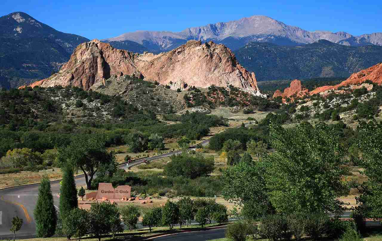 Scenic view of entrance and the panorama of Garden of the Gods Park near Colorado Springs CO with Pikes Peak on the horizon. (Photo by Universal Images Group via Getty Images)