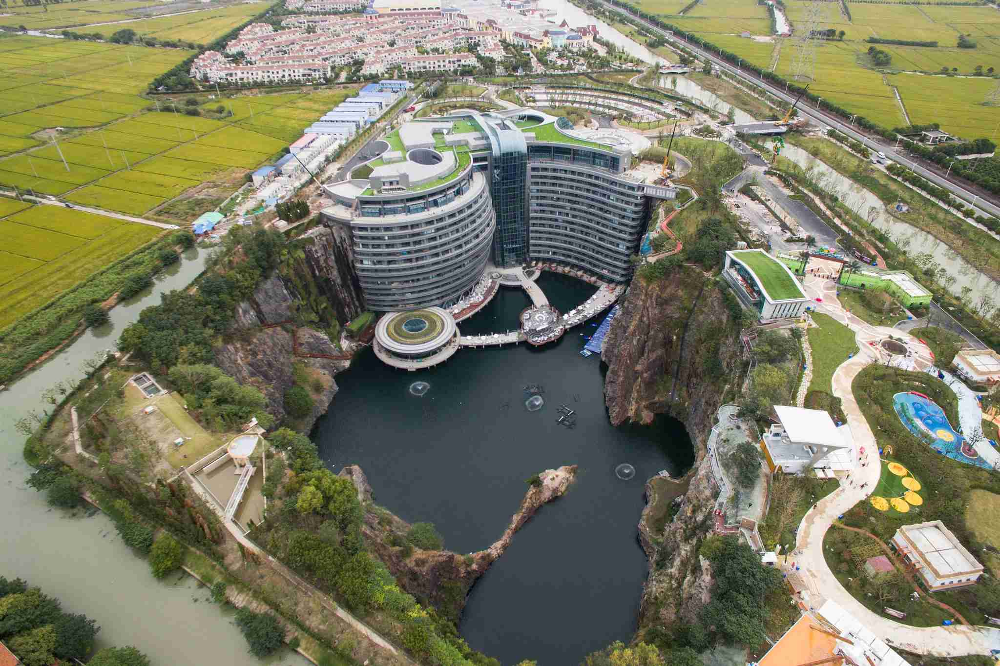 An aerial view of the luxury hotel InterContinental Shanghai Wonderland built inside a deserted quarry pit in southwestern Shanghai, China Wednesday, Oct. 10, 2018. The building has 18 floors, 16 of which are below ground including two submerged under water. After multiple delays, the hotel, designed by British firm Atkins, will finally open later this year.PHOTOGRAPH BY Feature China / Barcroft Images (Photo credit should read Feature China / Barcroft Images / Barcroft Media via Getty Images)