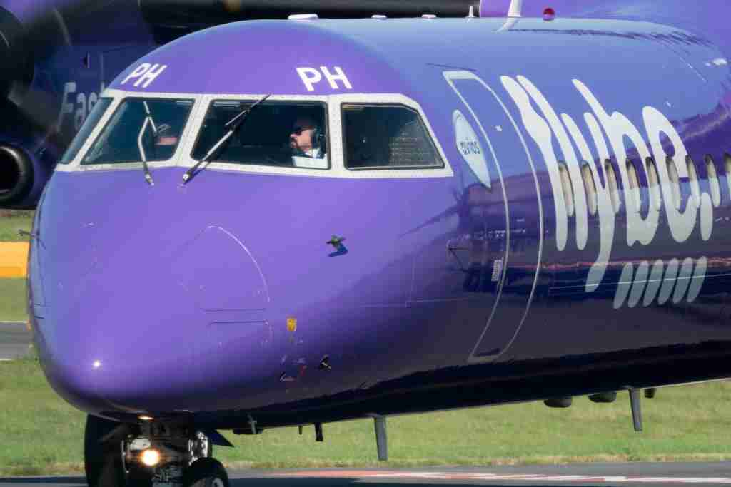 EXETER, ENGLAND - OCTOBER 18: A aircraft operated by the airline Flybe, taxis down the runway at Exeter Airport near Exeter on October 18, 2018 in Devon, England. The value of shares in the Exeter-based airline Flybe, have fallen dramatically recently after the company issued another profit warning, blaming poor demand, a weaker pound and higher fuel costs.(Photo by Matt Cardy/Getty Images)