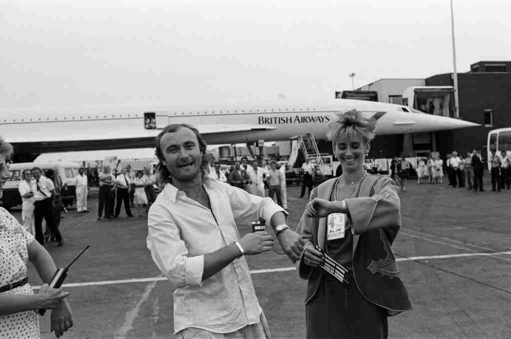 Singer Phil Collins and wife Jill Travelman at London Heathrow Airport. Phil Collins is about to board a Concorde flight to USA, in order to perform at the JFK Stadium in Philadelphia, in the Live Aid concert. Phil has already performed at the corresponding Live Aid show at Wembley Stadium, 13th July 1985. (Photo Dennis/Mirrorpix/Getty Images)
