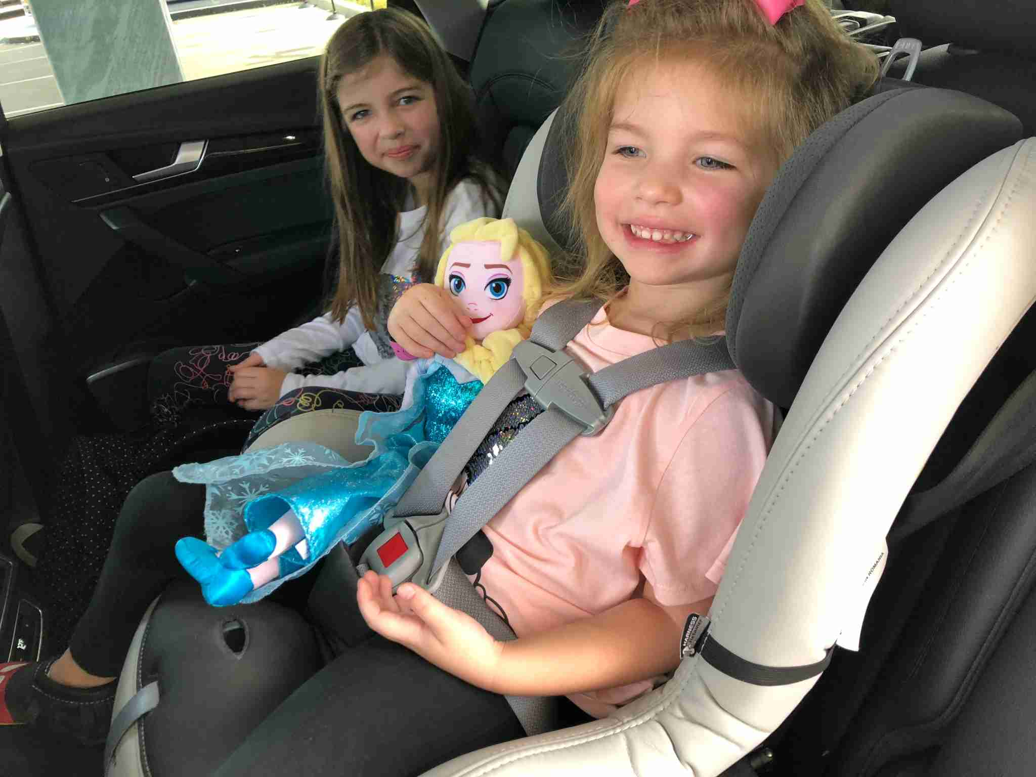 Happy in a free Silvercar car seat (Photo by Summer Hull / The Points Guy)