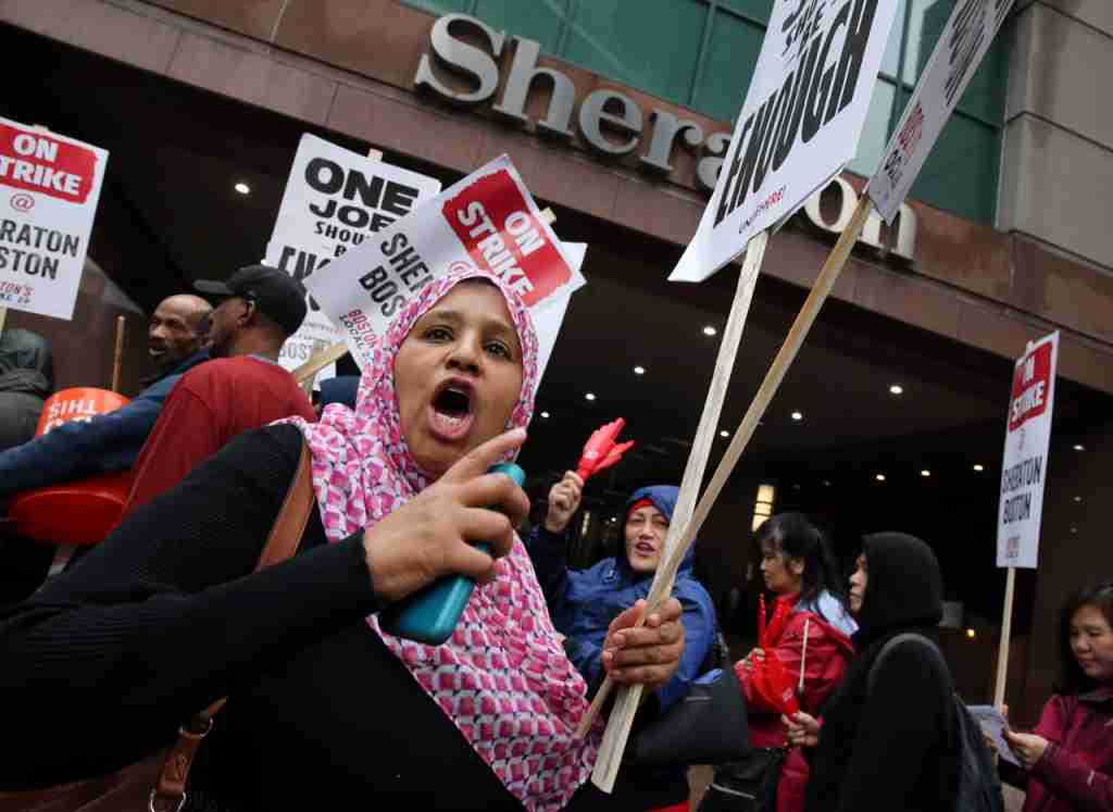 BOSTON, MA - OCTOBER 3: Hawa Diallo pickets outside the Sheraton Boston by Marriott, where she works in housekeeping, in Boston on Oct. 3, 2018. Hotel workers walked off the job at seven Marriott hotels in Boston Wednesday morning, launching the first hotel strike in the citys history following months of fruitless contract negotiations. The job action involves more than 1,500 Marriott International employees, from housekeepers to bartenders to bellmen at the Aloft Boston Seaport District, Element Boston Seaport District, Ritz-Carlton Boston, Sheraton Boston, W Hotel Boston, Westin Boston Waterfront, and Westin Copley Place. (Photo by Craig F. Walker/The Boston Globe via Getty Images)