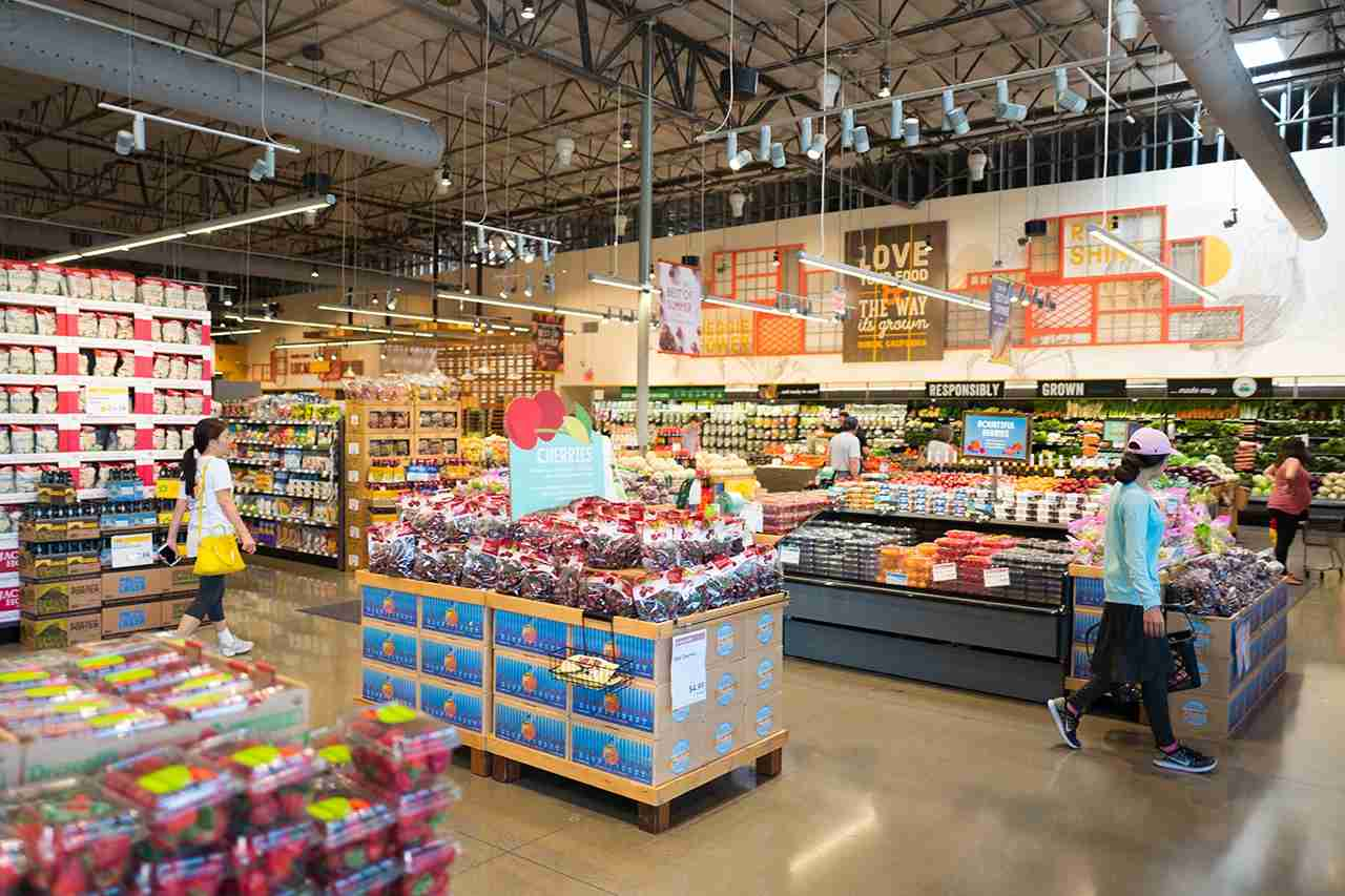 Shoppers browse the produce section at Whole Foods Market grocery store in Dublin, California, June 16, 2017, June 16, 2017. On June 16, 2017, Amazon.com announced that it would acquire the upscale grocery chain. (Photo via Smith Collection/Gado/Getty Images).
