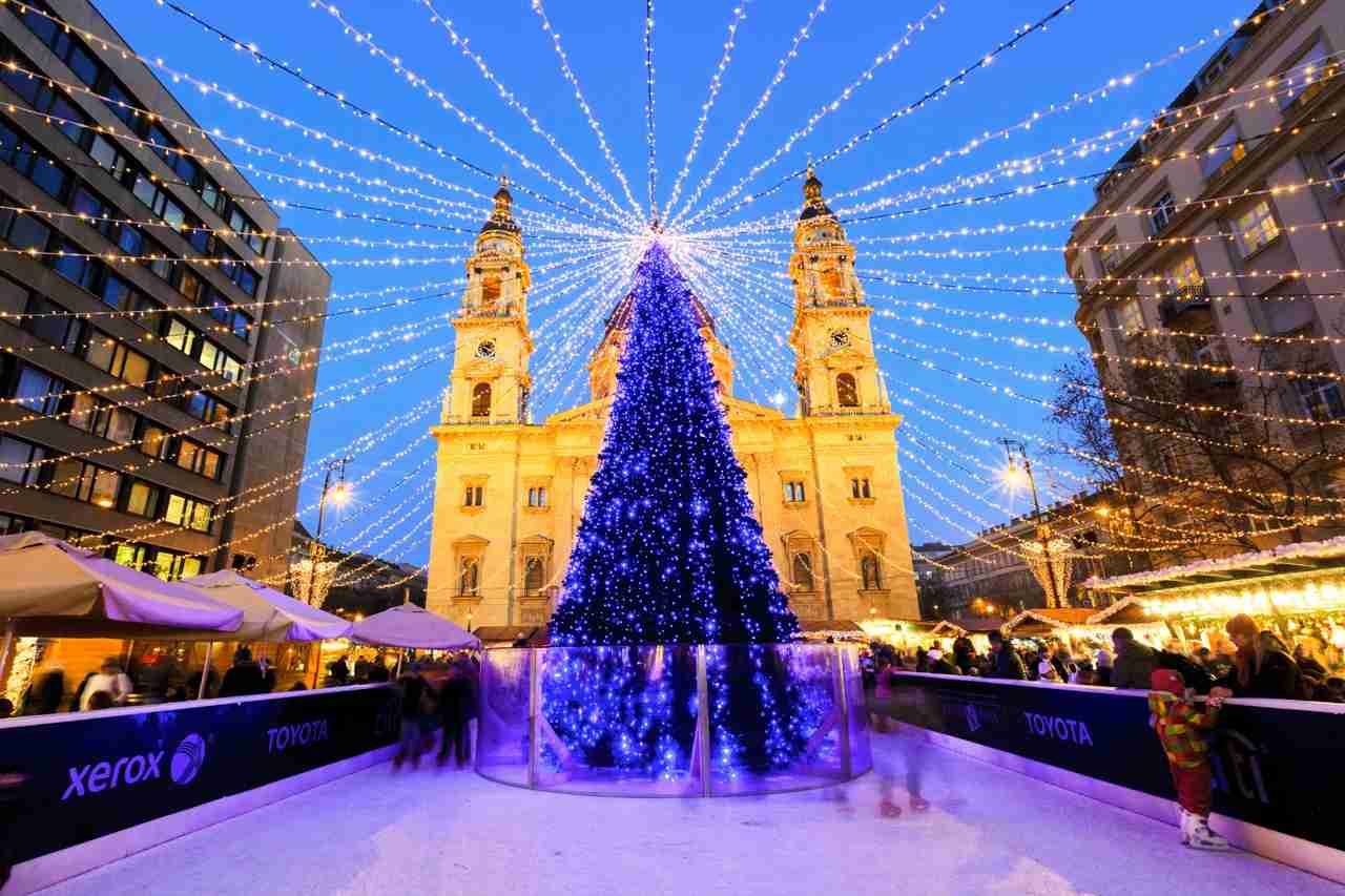 Tourists enjoy the Christmas lights at the St Steven Basilica in Budapest, Hungary. This traditional Christmas fair attracts abut 700,000 visitors each year. (budapest christmas market_photo via shutterstock)
