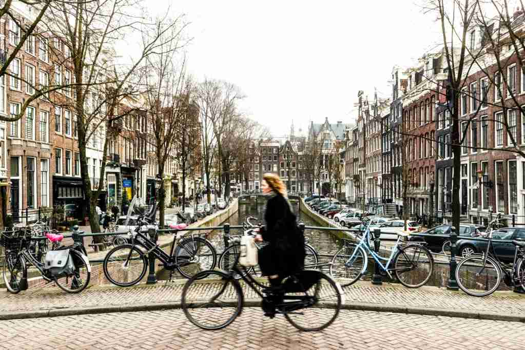 You can cycle through Amsterdam at all times of the year. (Photo via Shutterstock)