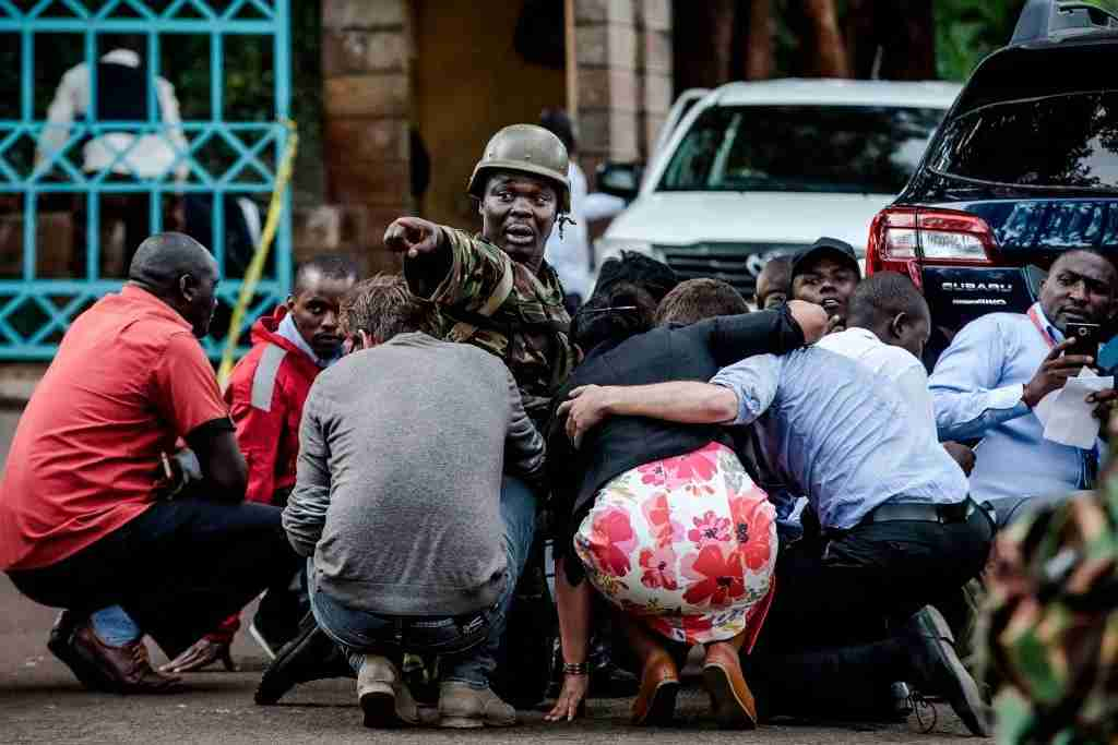 TOPSHOT - Special forces protect people at the scene of an explosion at a hotel complex in Nairobi