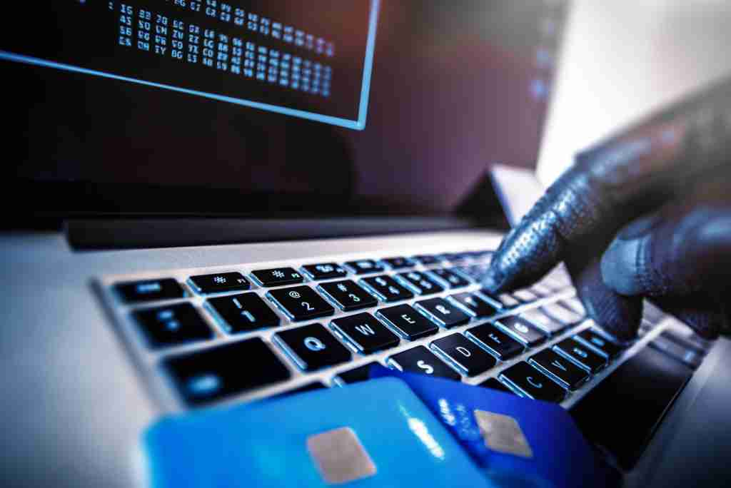 If a hacker gets hold of your debit card number, you could be on the hook for paying the bill. (Photo via Shutterstock)