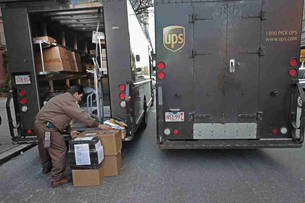 BOSTON, MA - DECEMBER 19: Two UPS trucks sit side by side on Newbury Street in Boston on Dec. 19, 2018. As some stressed shoppers scrambled on Wednesday to put presents under the tree less than a week before Christmas, many other consumers were sending items back to retailers. Atlanta-based United Parcel Service estimated that 1.5 million packages were being returned Wednesday, which the company had dubbed National Returns Day. UPS has been marking the day since 2012, but this year, for the first time, the designated day came before Christmas, thanks to the rise of e-commerce and the stretched-out Black Friday sales period. (Photo by David L. Ryan/The Boston Globe via Getty Images)