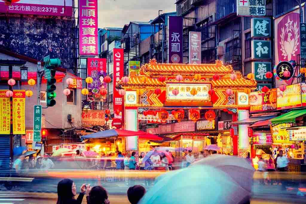 People gathering around Raohe Street Night Market in Taipei.