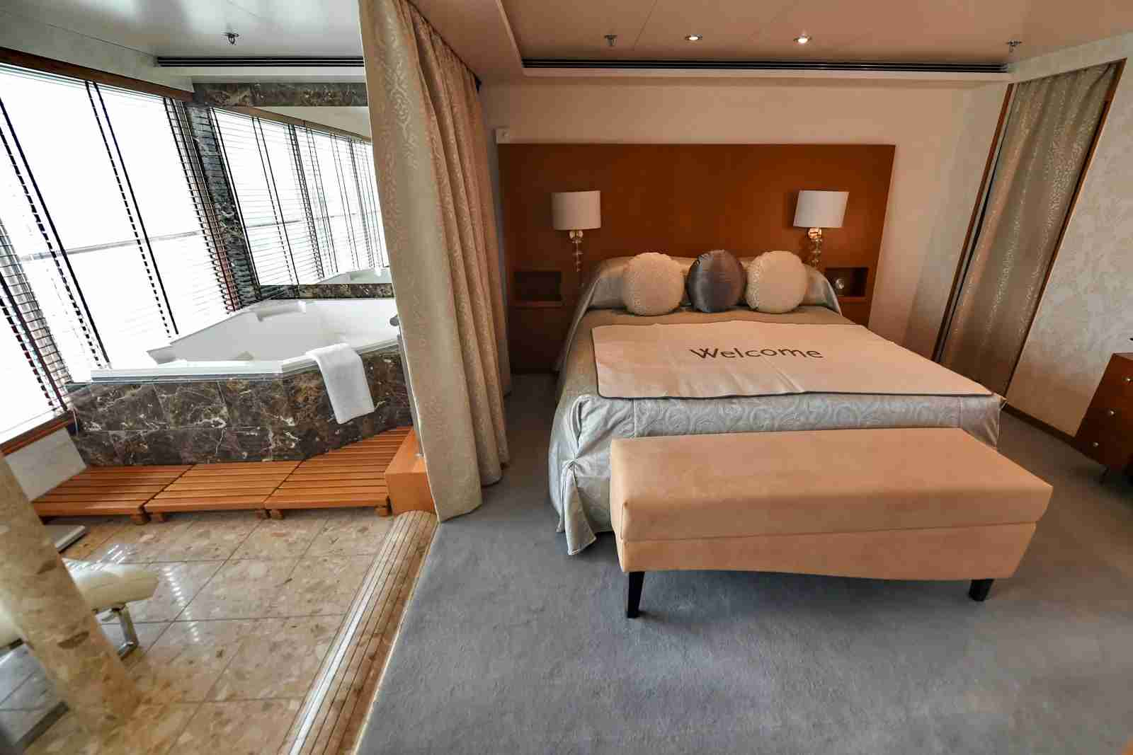 A view of the luxury suite inside the Regent Seven Seas Voyager cruise ship. (Photo by ROSLAN RAHMAN/AFP/Getty Images)