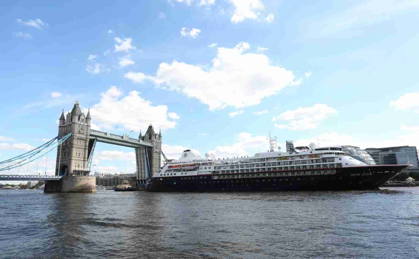 Silver Cloud, a luxury cruise ship operated by Silversea Cruises, leaves Tower Bridge in London. (Photo by Isabel Infantes/PA Images via Getty Images)