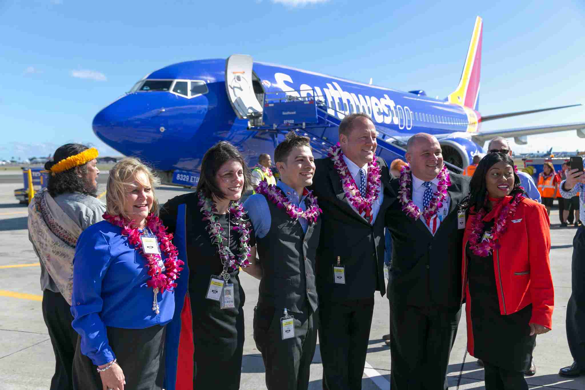 Southwest Airlines crew celebrate after landing for the first time at the Honolulu International Airport, Tuesday, February 5, 2019, in Honolulu. (Marco Garcia/The Points Guy)