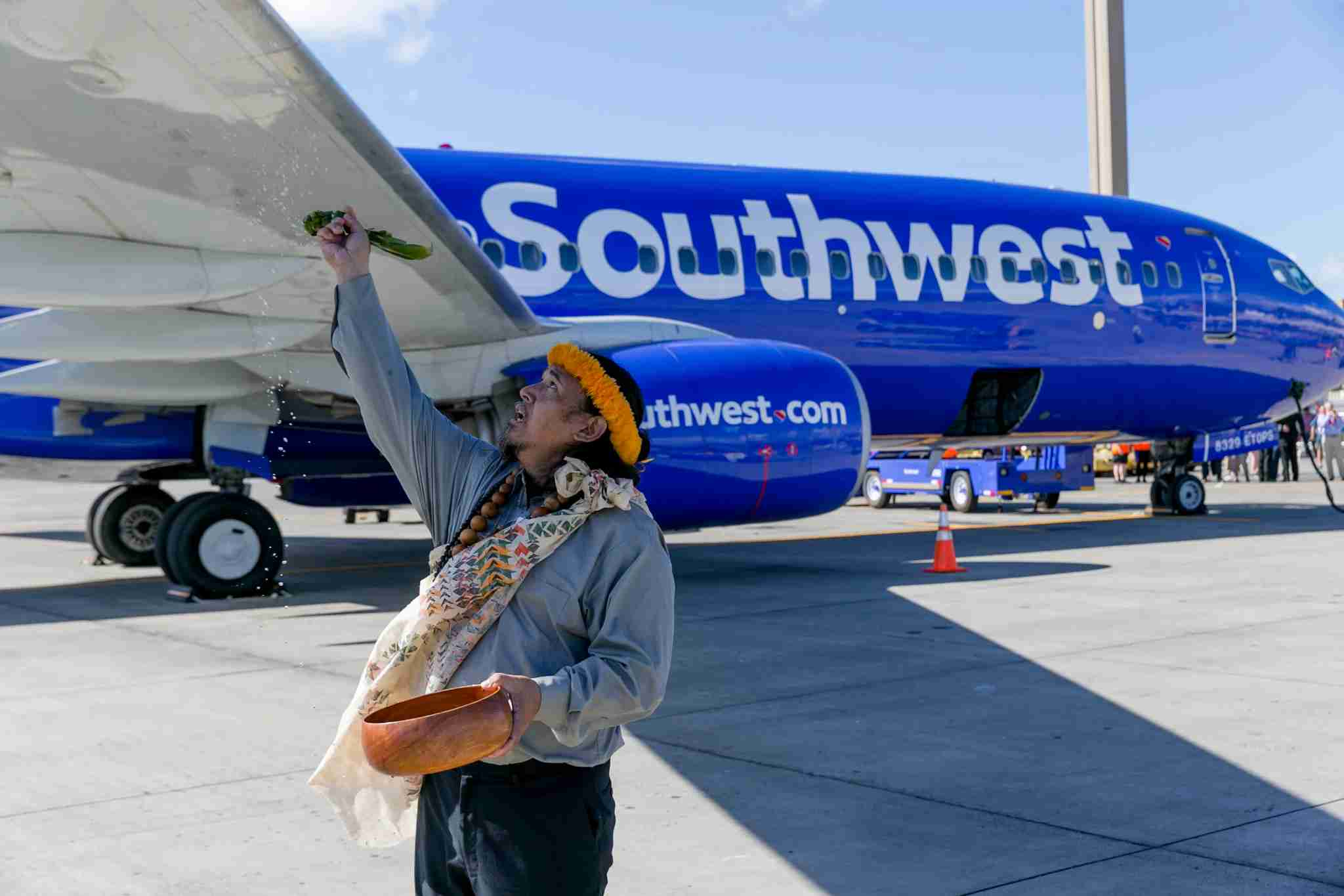 Hawaiian kahu Kalama Cabigon, a cultural practitioner, gives a Hawaiian blessing over the Southwest Airlines flight that landed for the first time at the Honolulu International Airport, Tuesday, February 5, 2019, in Honolulu. (Marco Garcia/The Points Guy)