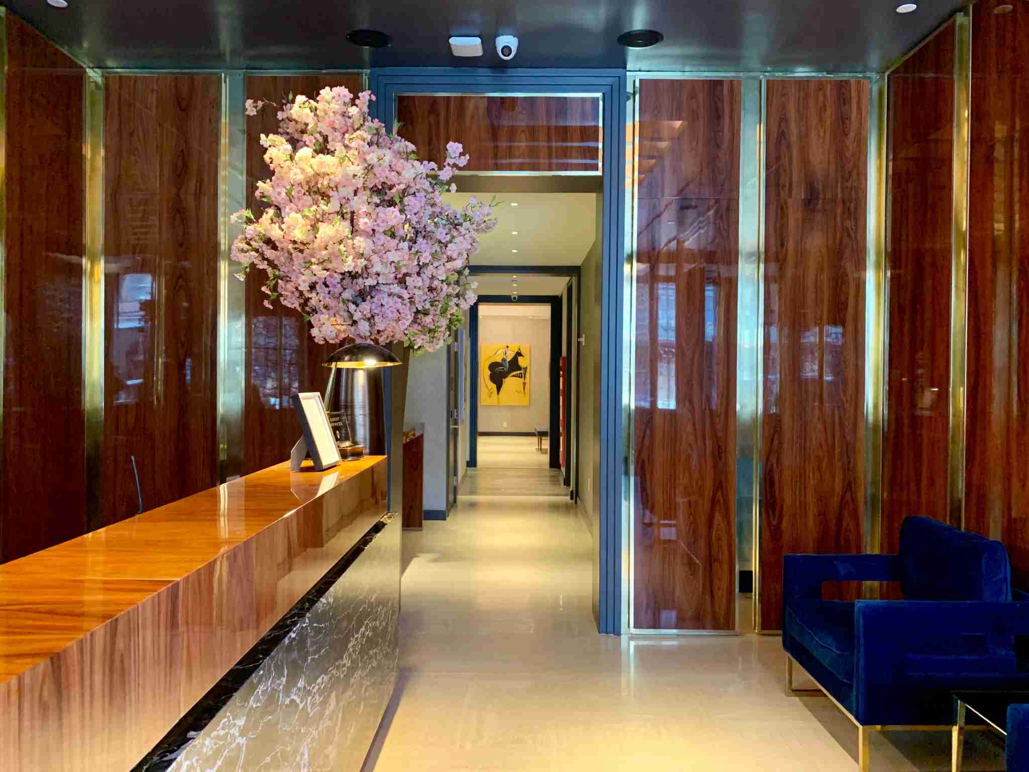 Glossy wood abounds in the Mr. C Seaport check-in lobby