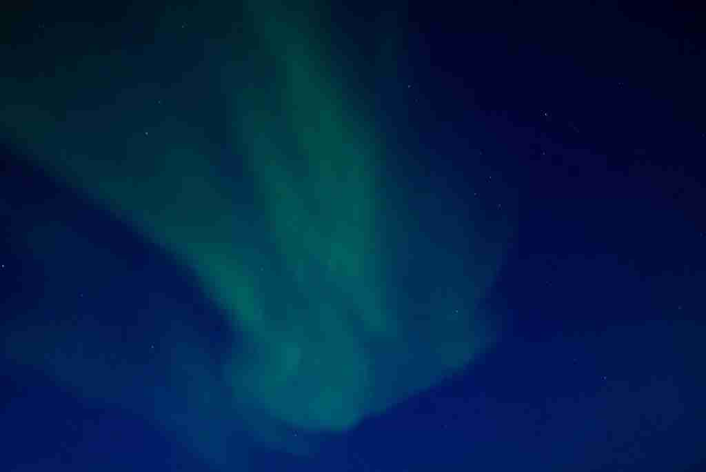 A successful shot of the Northern Lights, taken from behind an airplane window. (Photo via Shutterstock_