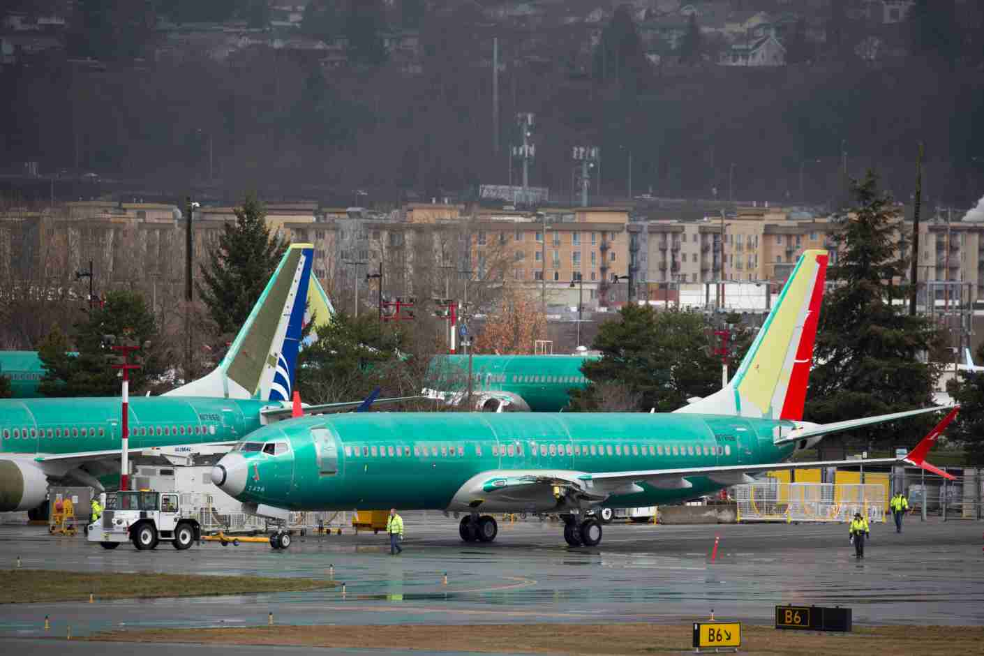 """Boeing 737 airplanes are pictured on the tarmac at the Boeing Renton Factory in Renton, Washington on March 12, 2019. - The US said there is """"no basis"""" to ground Boeing 737 MAX airplanes, after a second deadly crash involving the model in less than five months prompted governments worldwide to ban the aircraft. """"Thus far, our review shows no systemic performance issues and provides no basis to order grounding the aircraft,"""" Federal Aviation Administration (FAA) chief Daniel Elwell said in a statement. (Photo by Jason Redmond / AFP) (Photo credit should read JASON REDMOND/AFP/Getty Images)"""