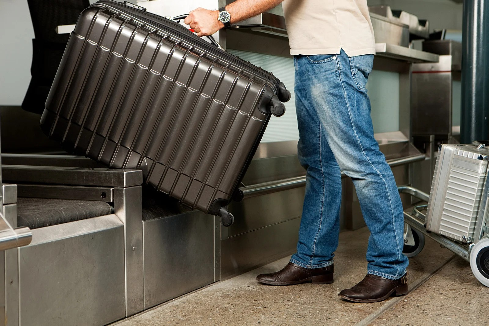 There Are Legit Ways to Avoid Airline Bag Fees — Your Foot Isn't One of Them