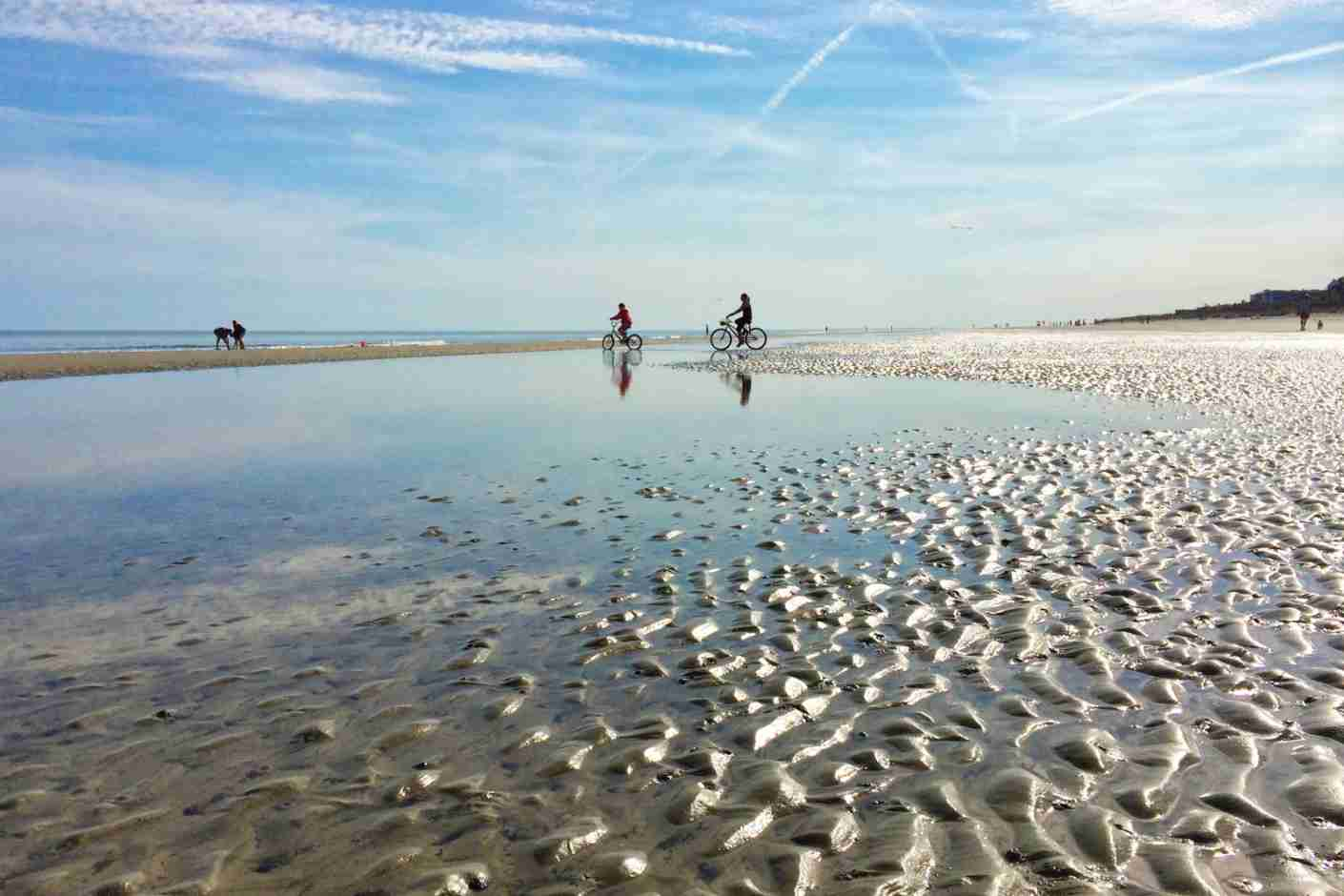 Bicyclists and beach combers on a Hilton Head Island, SC beach at low tide. (Photo via Getty Images)