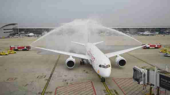 Fire engines spray water over an Ethiopian Airlines