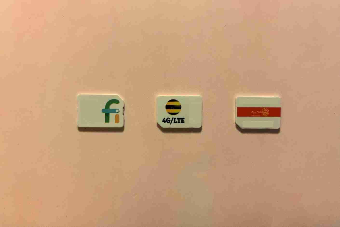My Google Fi SIM card next to SIM cards from Kazakhstan and Solomon Islands. I
