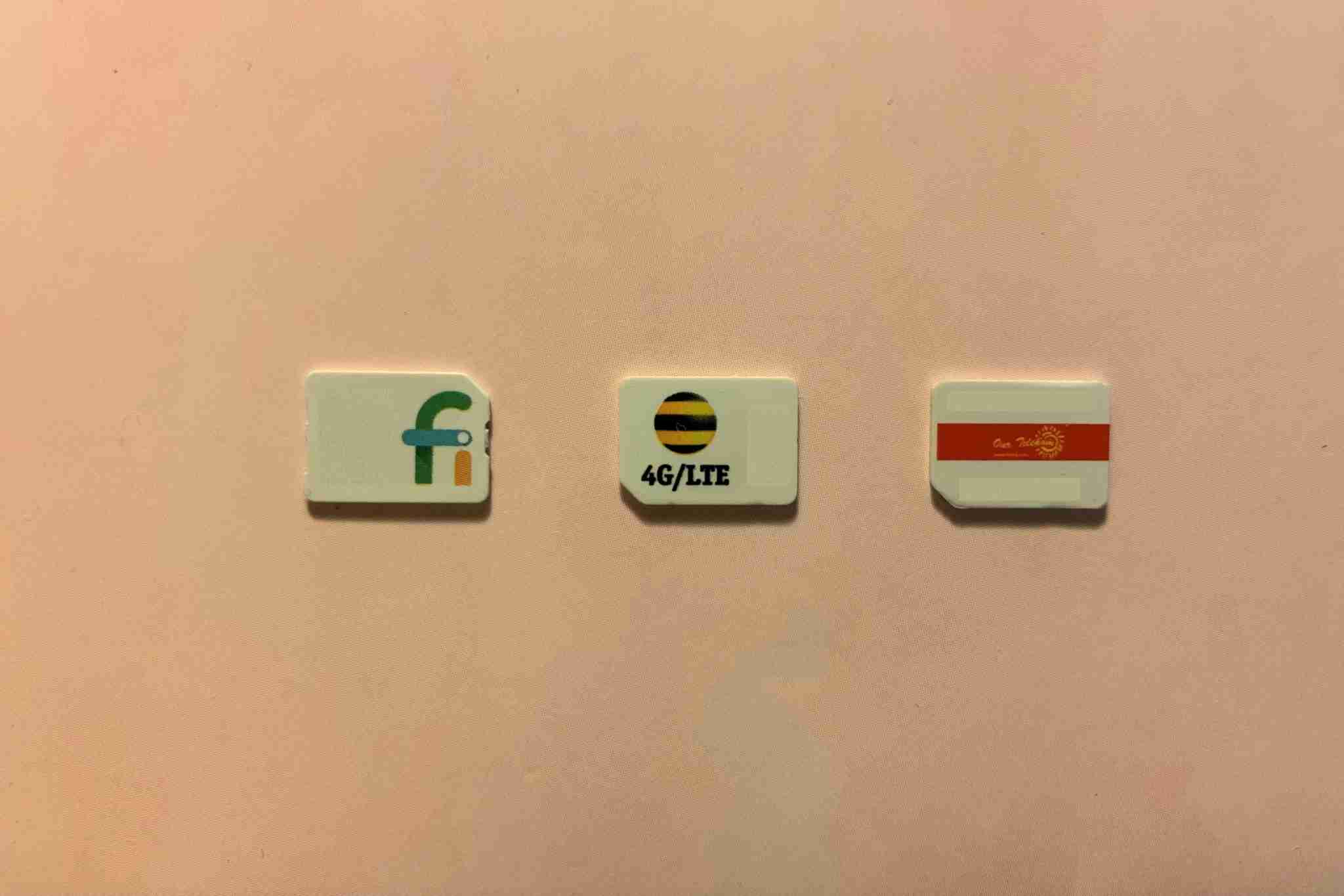 My Google Fi SIM card next to SIM cards from Kazakhstan and Solomon Islands. I