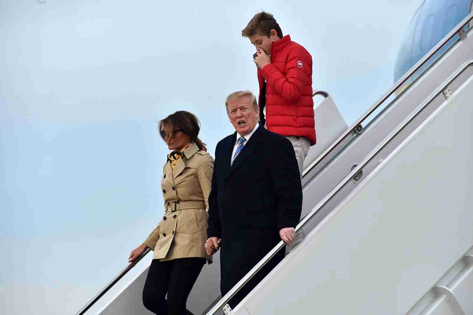 US President Donald Trump steps off Air Force One with first lady Melania and son Barron at Andrews Air Force Base in Maryland following the weekend at Trump