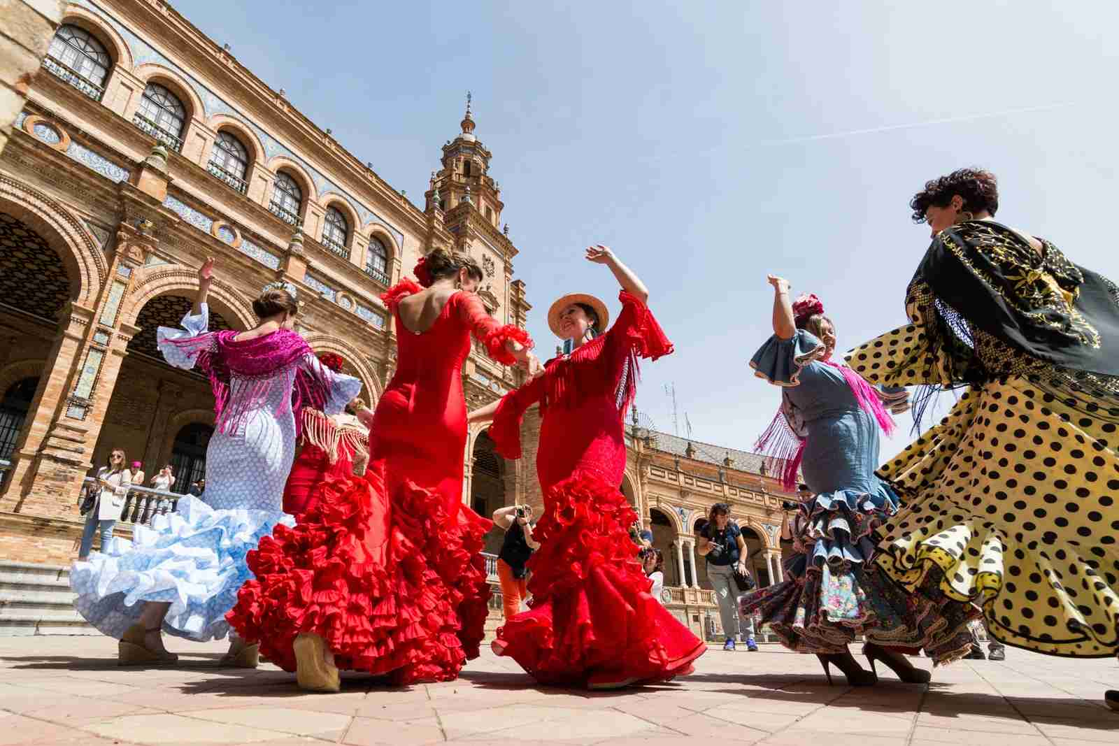 Women dancing flamenco on Plaza de Espana during Seville