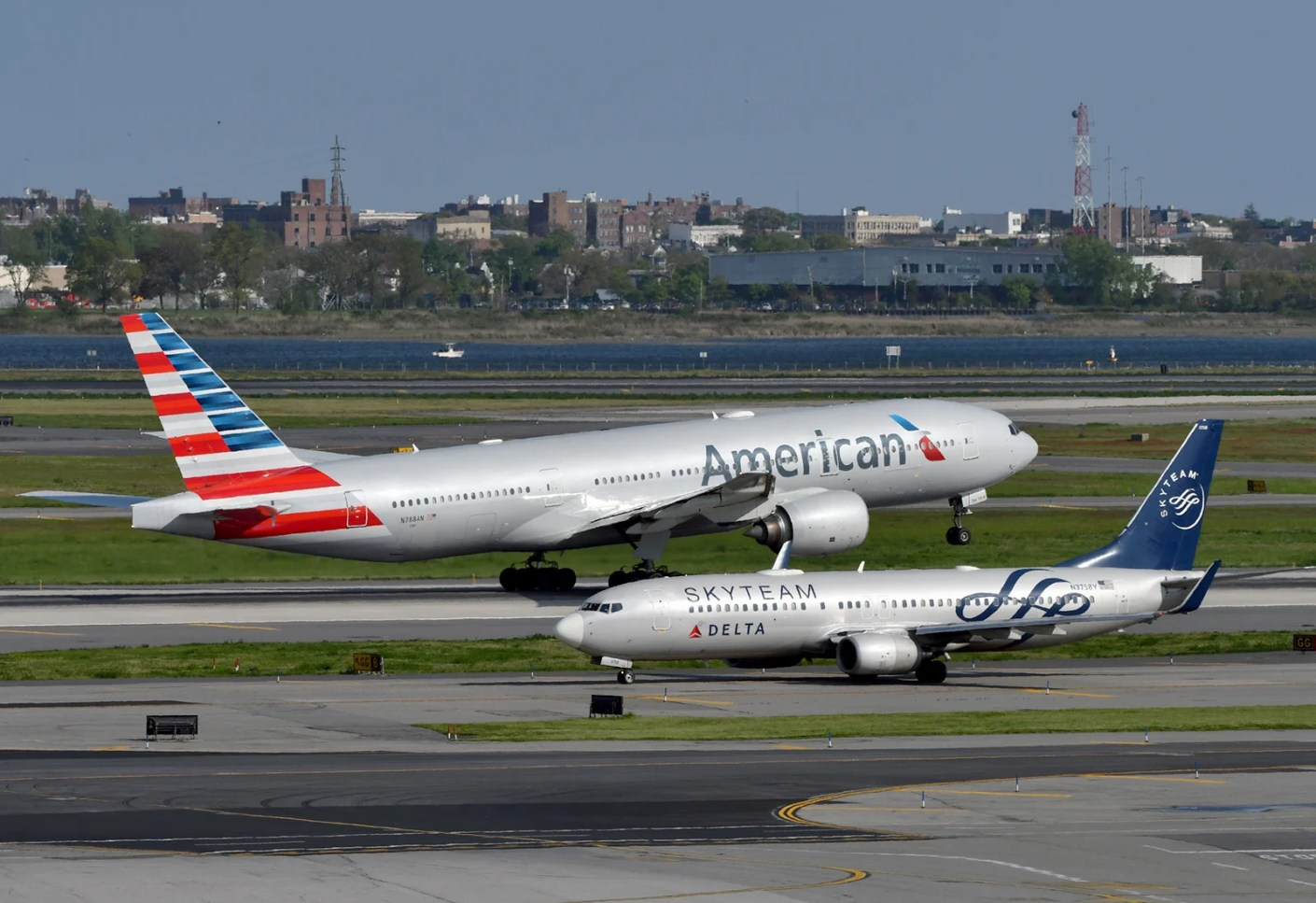 An American Airlines 777 and a Delta 737 seen from the roof deck at the TWA Hotel, JFK airport