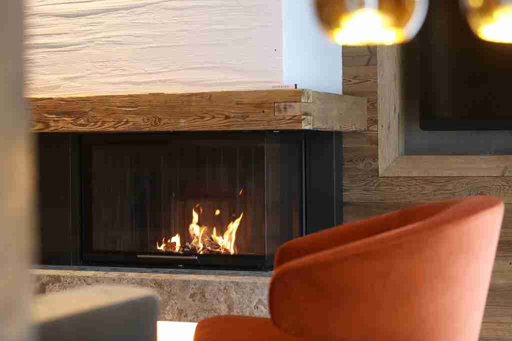 Cozy up to a fire in your Austrian junior suite at Severin