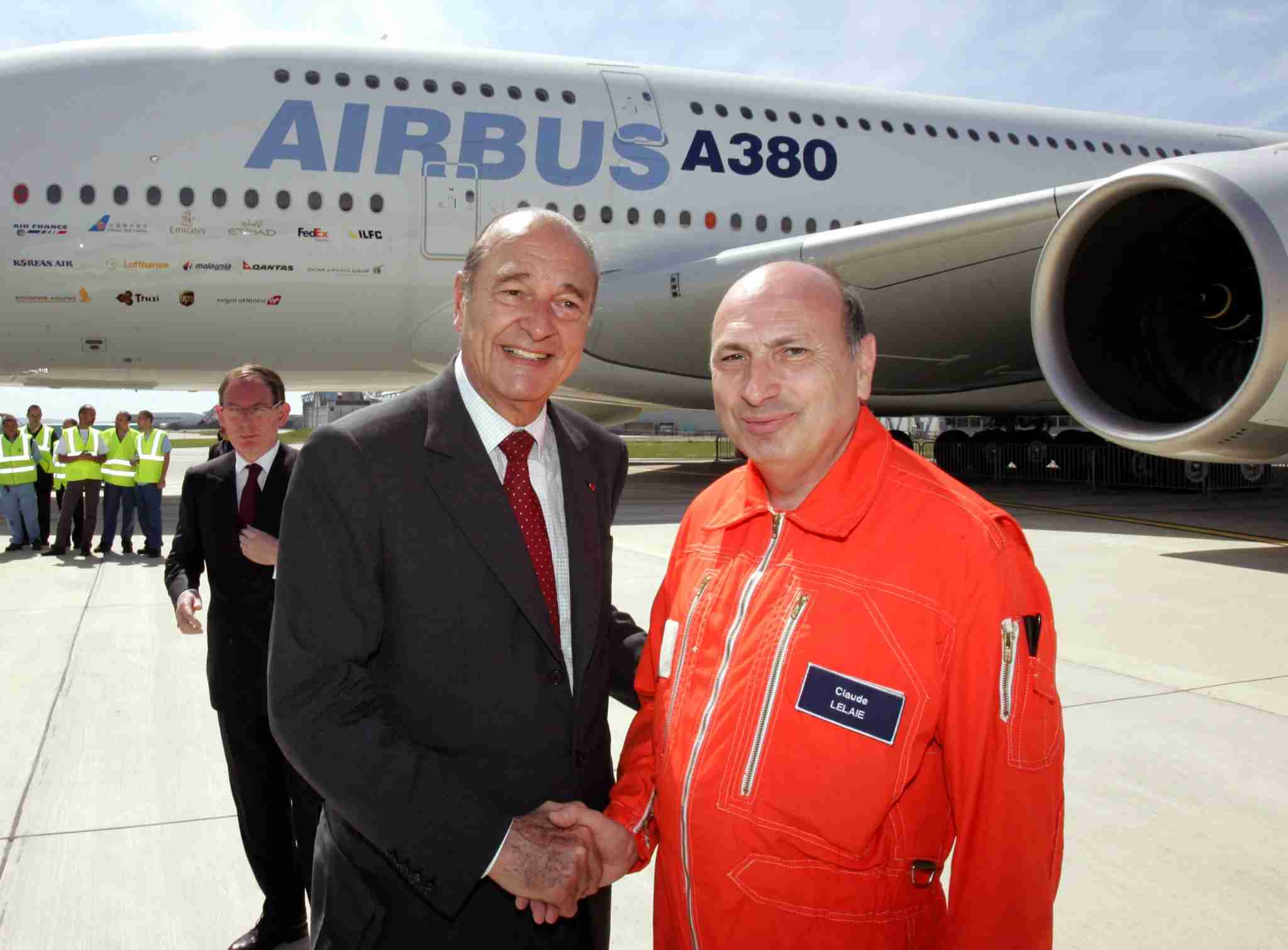 French president Jacques Chirac (L) shakes hands with Claude Lelaie, a pilot of the world