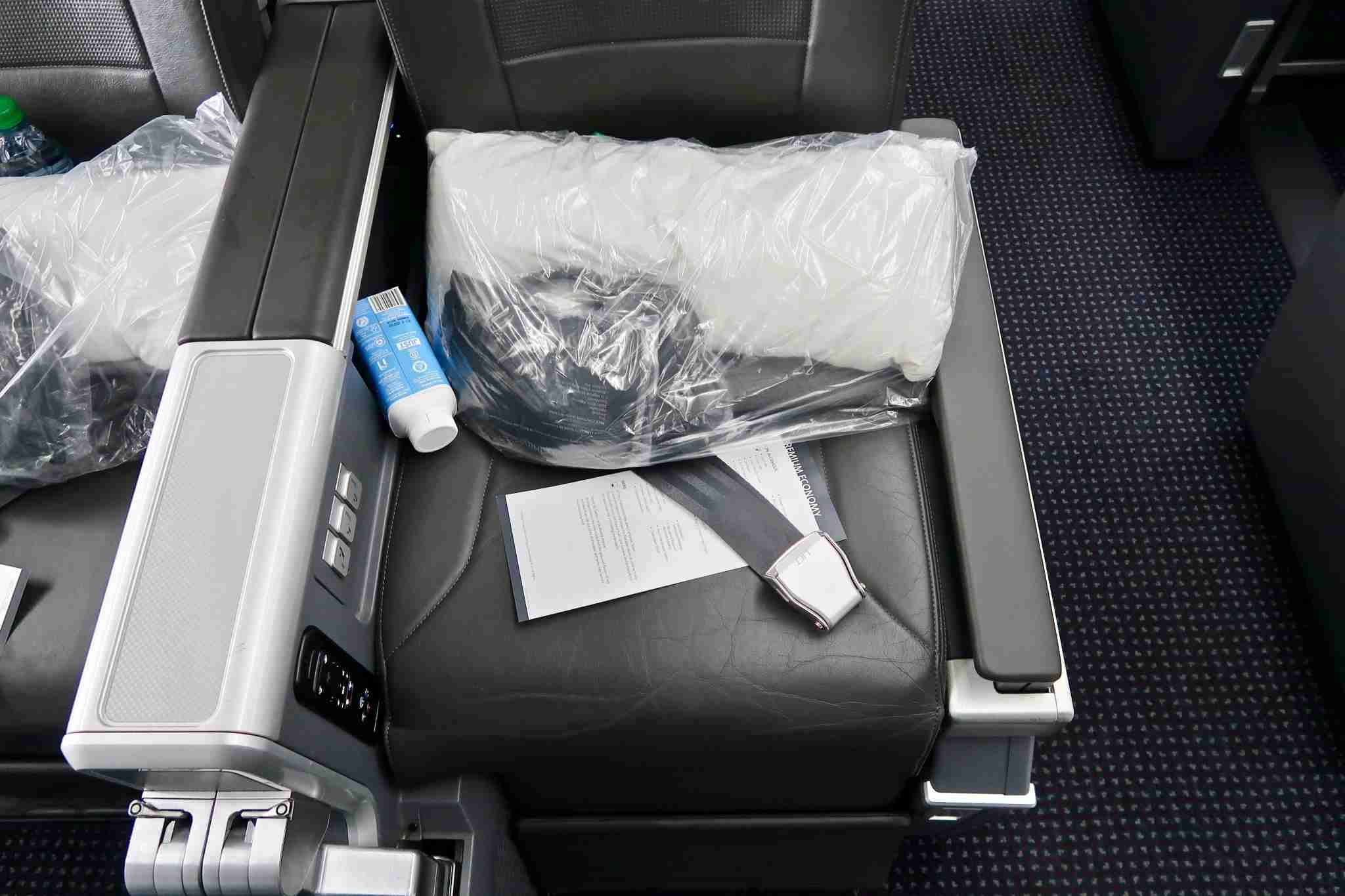 Premium economy amenities at boarding. Photo by Christian Kramer / The Points Guy.