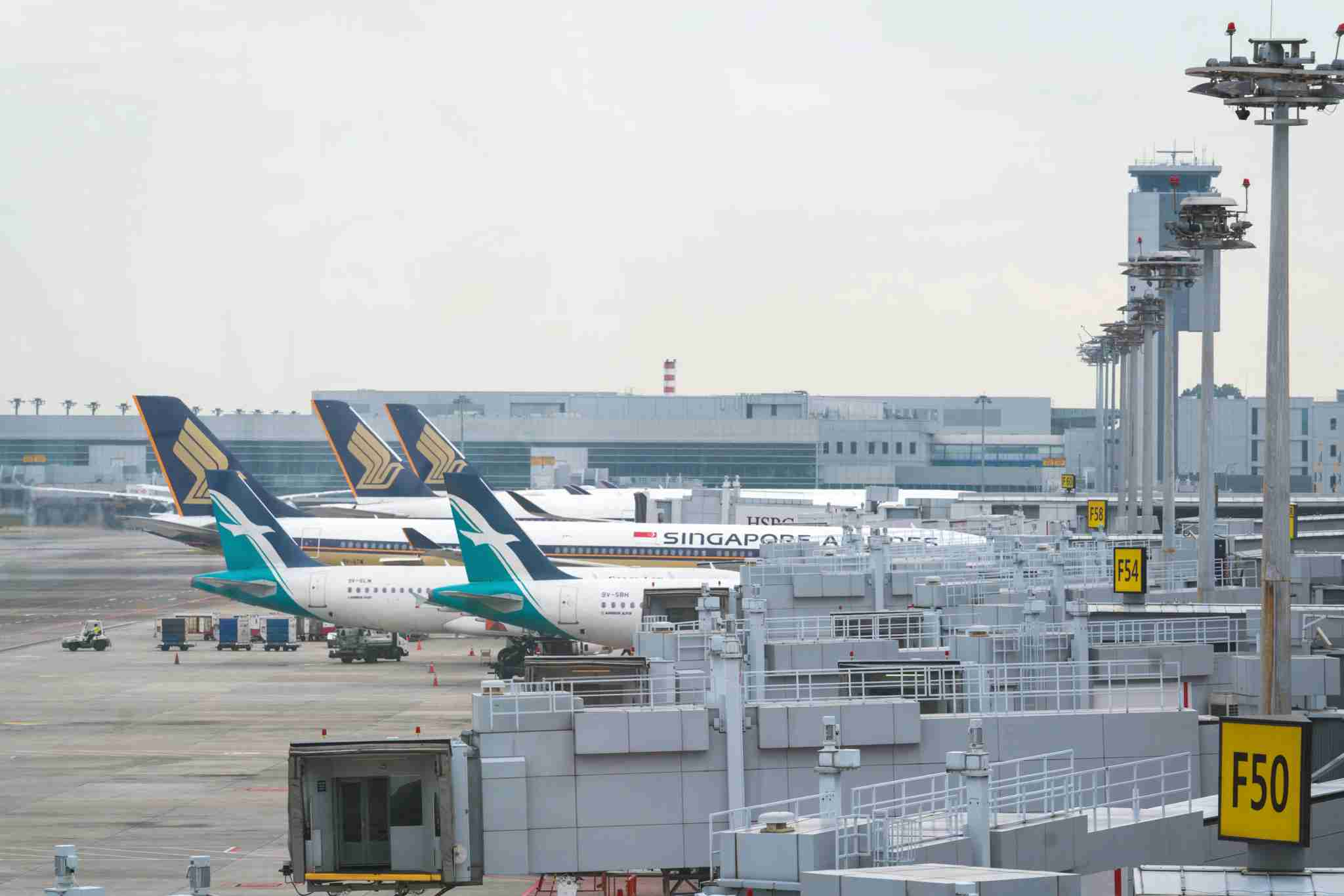 Singapore Airlines and SilkAir aircraft at Singapore-Changi Airport (SIN) (Image by Nicky Loh/Bloomberg via Getty Images)