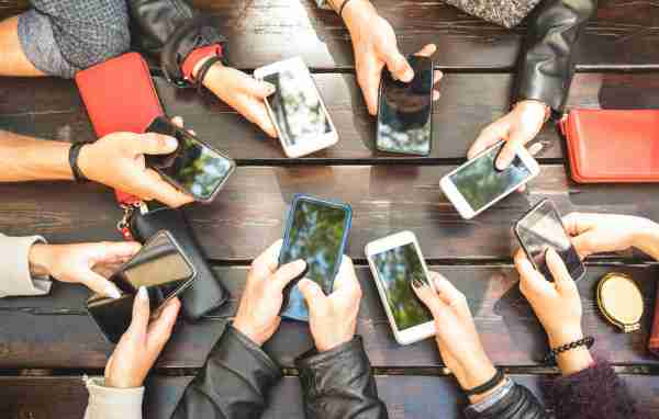 People group having addicted fun together using smartphones - Detail of hands sharing content on social network with mobile smart phones - Technology concept with millennials online with cellphones (People group having addicted fun together using smar