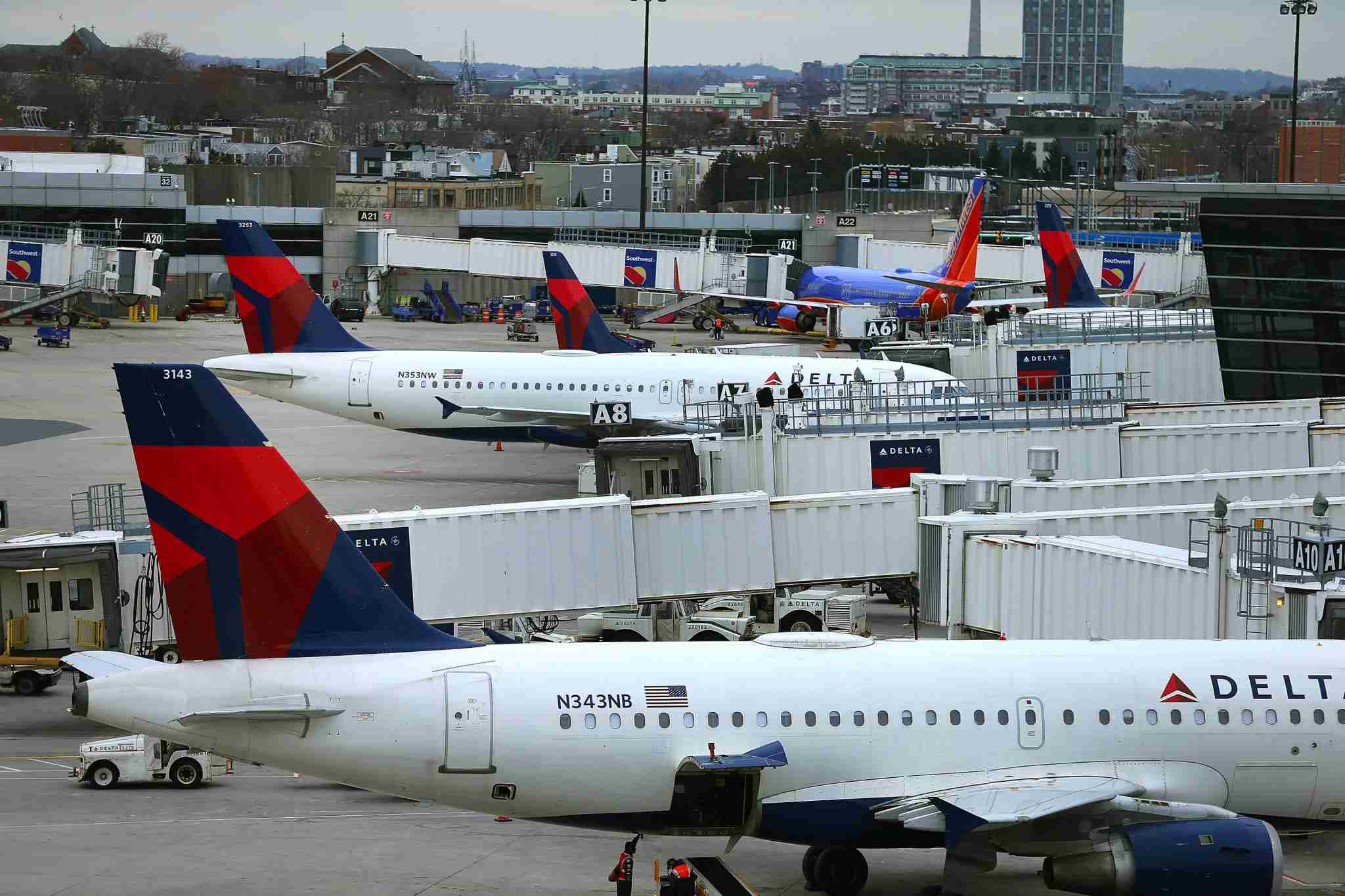 Delta and Southwest aircraft parked at terminal A at Boston Logan. (Photo by John Tlumacki/The Boston Globe via Getty Images)