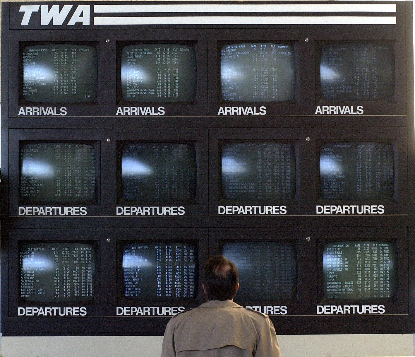 Departure and arrival boards at St. Louis-Lambert International Airport in 2001 when Trans World Airlines operated its largest hub at the airport. (Photo by Bill Greenblatt/Liaison)