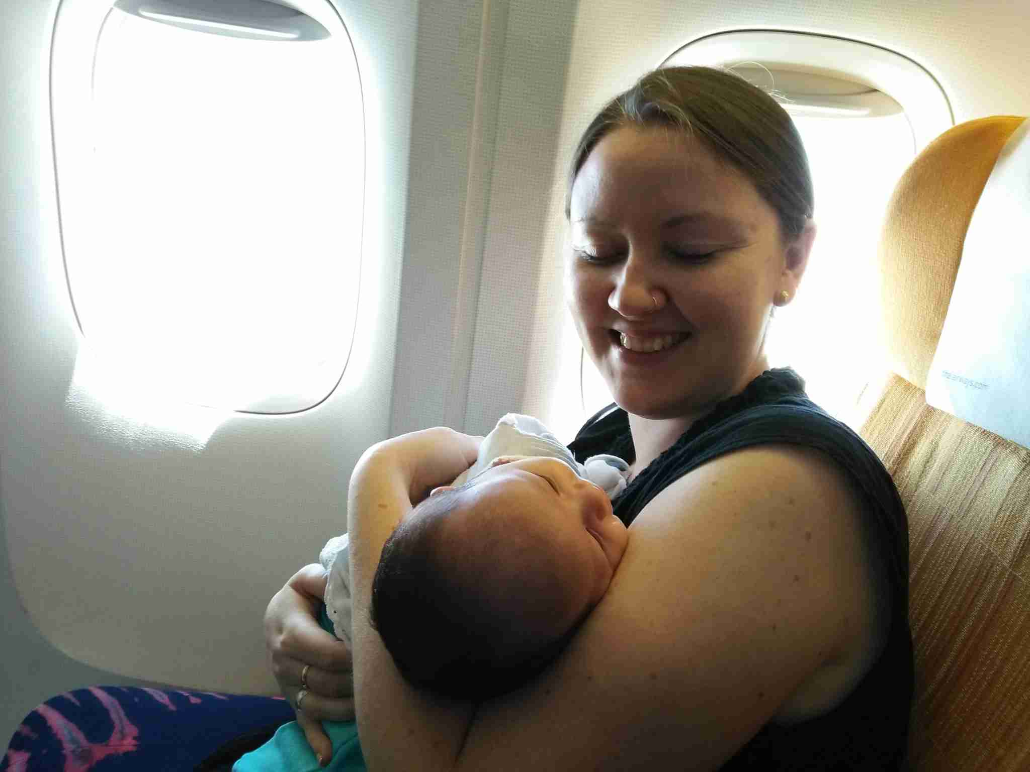 My one-month-old daughter on her first international flight, from Bangkok to Kathmandu