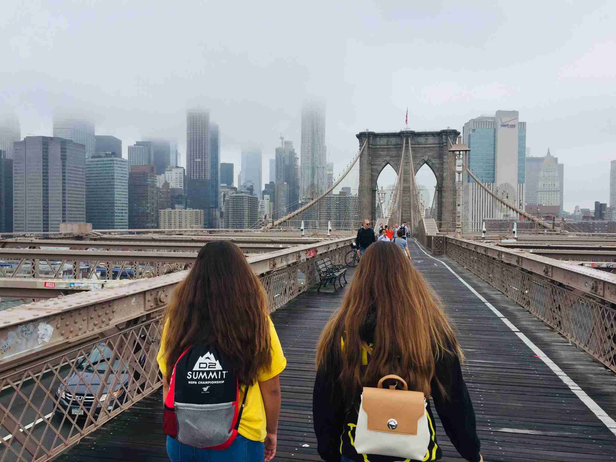 With Manhattan draped in morning clouds, our walk across the Brooklyn Bridge was epic. (photo by 2DadsWithBaggage.com)