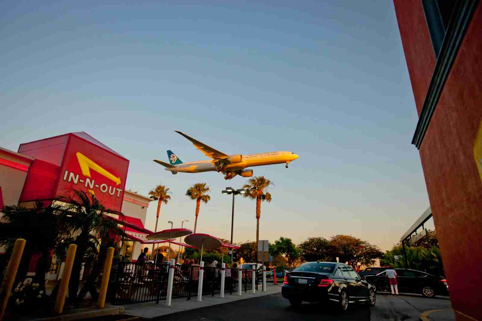 Airplane flying over the In-n-Out Burger near LAX. (Photo by anouchka / Getty Images_