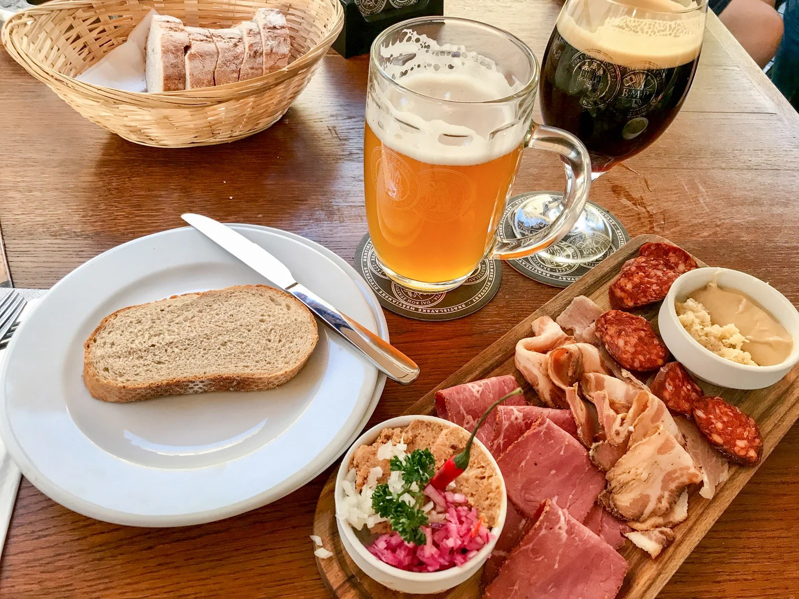 Plates of homemade sausage, juniper bacon and other meats are among the food options at Bratislava Meštiansky Pivovar.Photo by Gene Sloan / The Points Guy